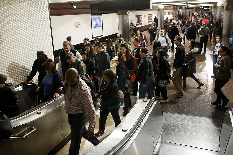 Commuters leave the Montgomery BART station during the morning commute in San Francisco. Photo: Liz Hafalia, The Chronicle