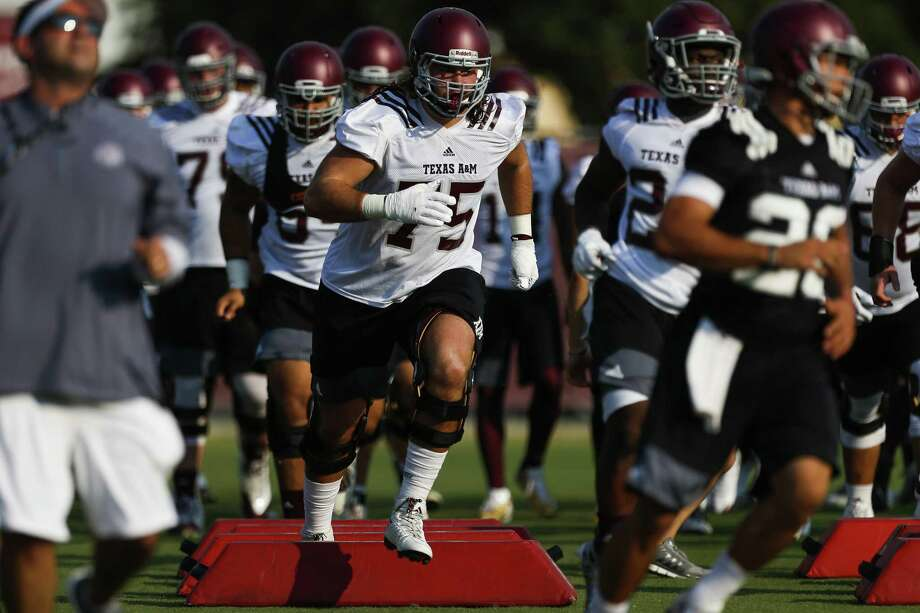 Texas A&M offensive lineman Koda Martin (center) runs through drills during the first day of practice on Aug. 4, 2017 in College Station. Photo: Michael Ciaglo /Houston Chronicle / Michael Ciaglo