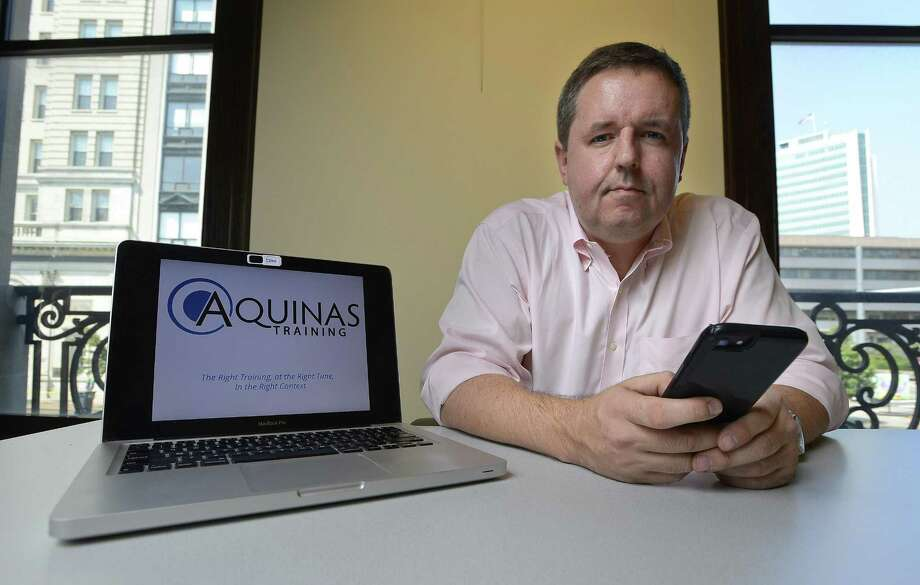 Hugh Seaton, CEO and founder of Aquinas Training, a new digital HR firm is photographed on August 3, 2017, at Old Town Hall in Stamford. Connectict. Seaton often conducts meetings with clients at Old Town Hall, which is used as co-op space shared by startups. Photo: Matthew Brown / Hearst Connecticut Media / Stamford Advocate