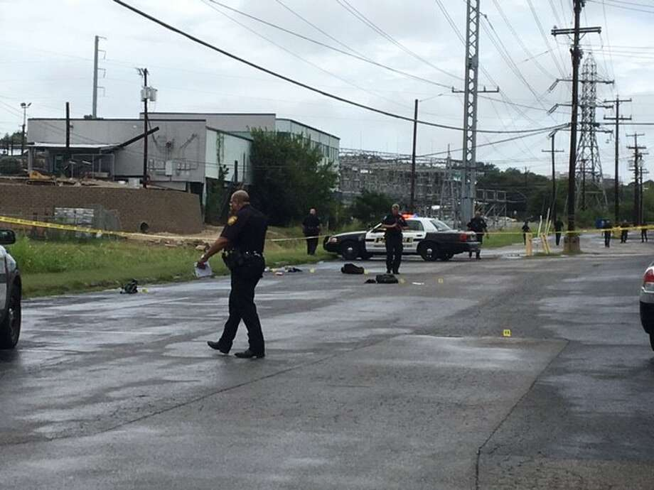 A shooting in the parking lot of San Antonio Technology Center in the 3400 block of Magic Drive on the Northwest Side sent two people to the hospital on Monday, Aug. 7, 2017. Photo: Caleb Downs / San Antonio Express-News