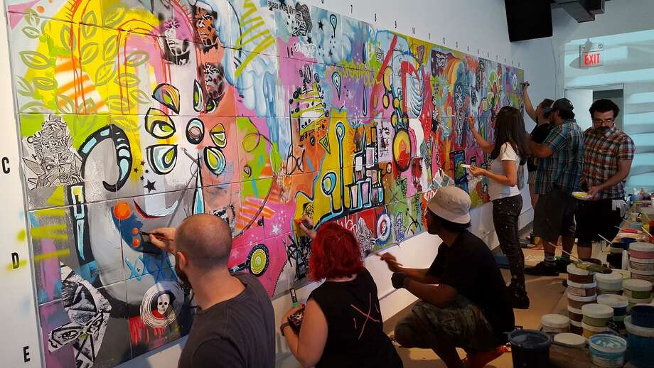 "Stamford's Danger Gallery sold out its latest show, ""1X1,"" for which seven Connecticut artists -- Holly Danger, Marc DeRosa, Marcella Kovac, Ben Quesnel, Cris Dam, Liz Squillace and Jahmane Artz -- painted a mural in front of 200 guests on Aug. 5. Photo: Contributed"