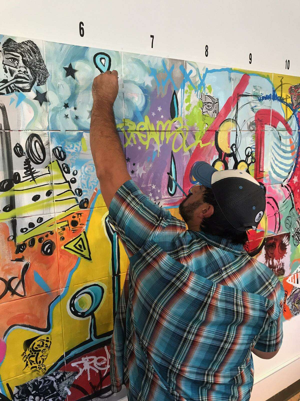 """Stamford's Danger Gallery sold out its latest show, """"1X1,"""" for which seven Connecticut artists -- Holly Danger, Marc DeRosa, Marcella Kovac, Ben Quesnel, Cris Dam, Liz Squillace and Jahmane Artz -- painted a mural in front of 200 guests on Aug. 5."""