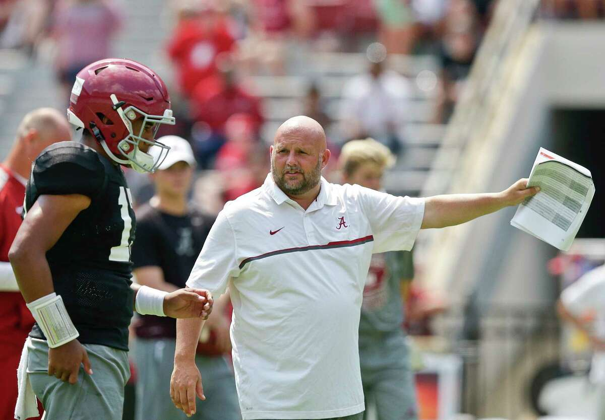 FILE - In this Aug. 5, 2017, file photo, Alabama offensive coordinator Brian Daboll, right, gestures while speaking to quarterback Jalen Hurts during an NCAA college football practice at BryantÂ?-Denny Stadium, in Tuscaloosa, Ala. Alabama and the Southeastern Conference are trying to climb back atop the college football mountain. The SEC was toppled at least temporarily from that summit by the Atlantic Coast Conference last season.(AP Photo/Brynn Anderson, File)