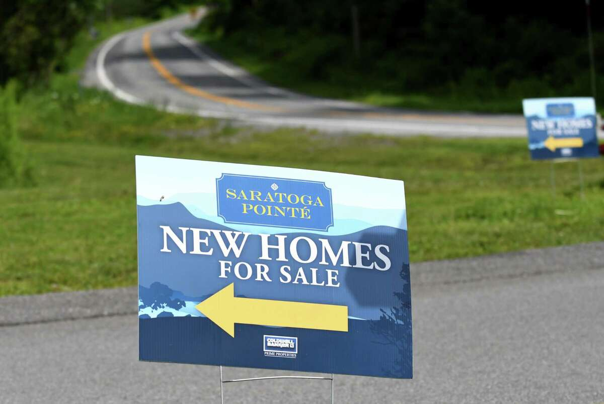 Signs outside Saratoga Pointe, a new development on Route 423 near Saratoga Lake on Friday, July 28, 2017, in Stillwater, N.Y. (Will Waldron/Times Union)