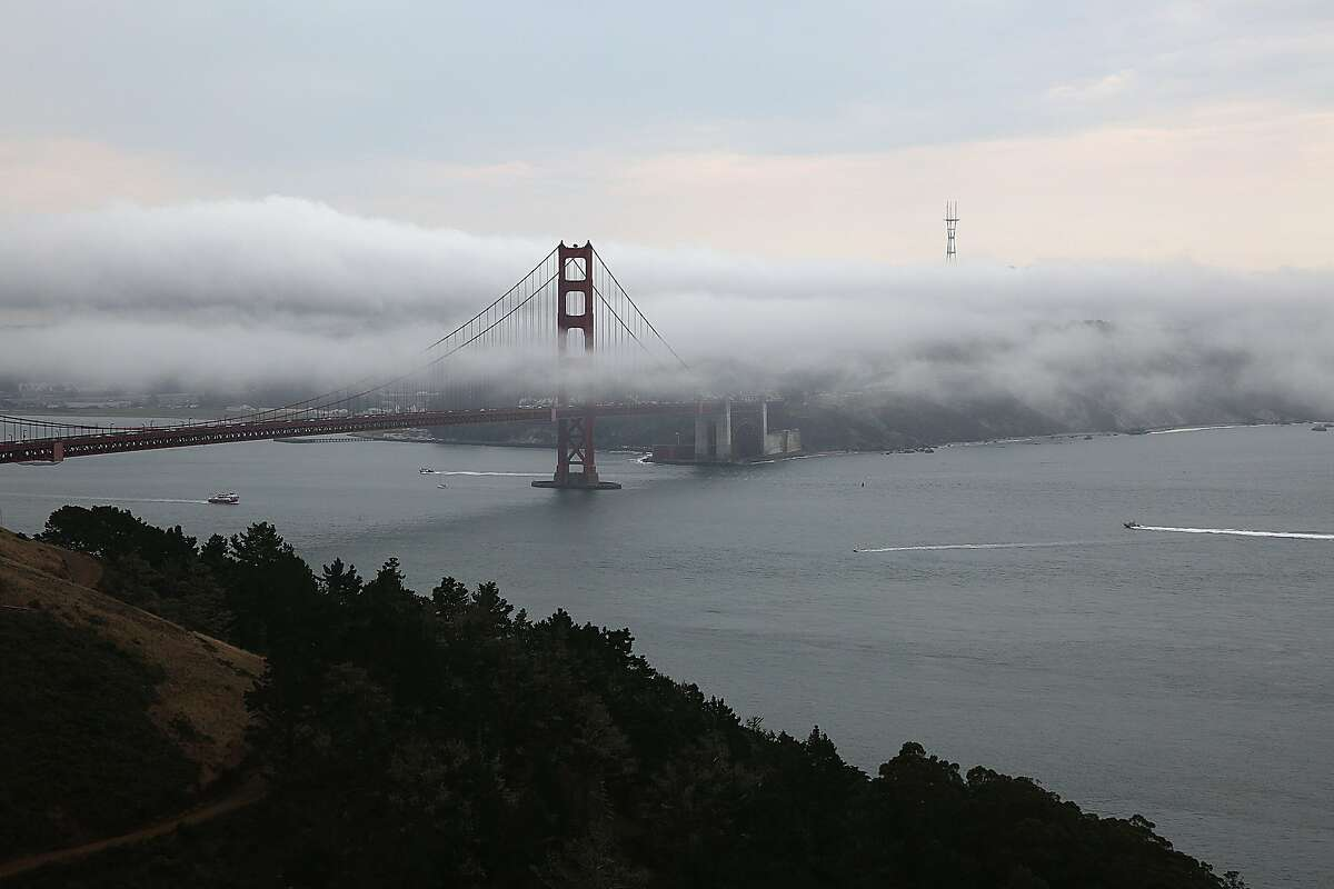Fog surrounds the Golden Gate bridge on Friday, August 4, 2017, in Marin County, Calif.