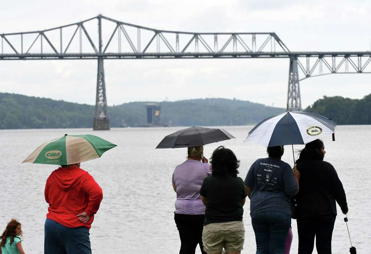 Spectators at Dutchman's Landing Park watch as 130 foot tall steam generator that was assembled at the Port of Coeymans is transported down the Hudson River past Rip Van Winkle Bridge on Monday, Aug. 7, 2017, in Catskill, N.Y. The generator was built for plant in New Jersey. (Will Waldron/Times Union)