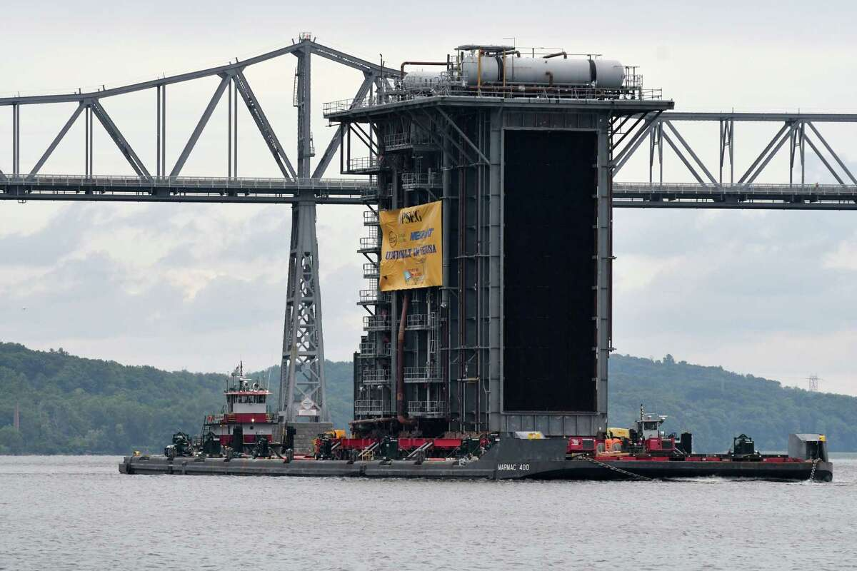 A 130 foot tall steam generator that was assembled at the Port of Coeymans is transported down the Hudson River past Rip Van Winkle Bridge on Monday, Aug. 7, 2017, in Catskill, N.Y. The generator was built for plant in New Jersey. (Will Waldron/Times Union)