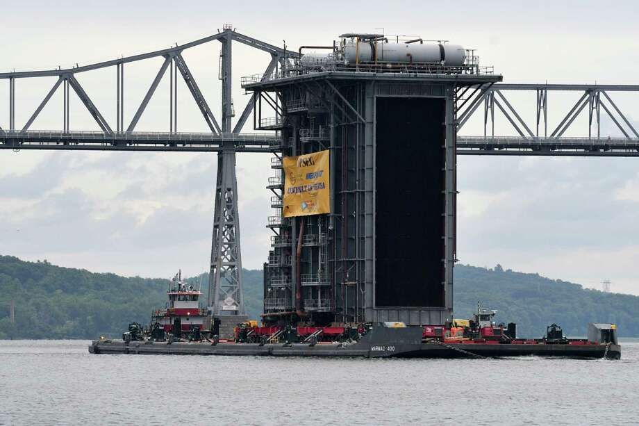 A 130 foot tall steam generator that was assembled at the Port of Coeymans is transported down the Hudson River past Rip Van Winkle Bridge on Monday, Aug. 7, 2017, in Catskill, N.Y. The generator was built for plant in New Jersey. (Will Waldron/Times Union) Photo: Will Waldron, Albany Times Union