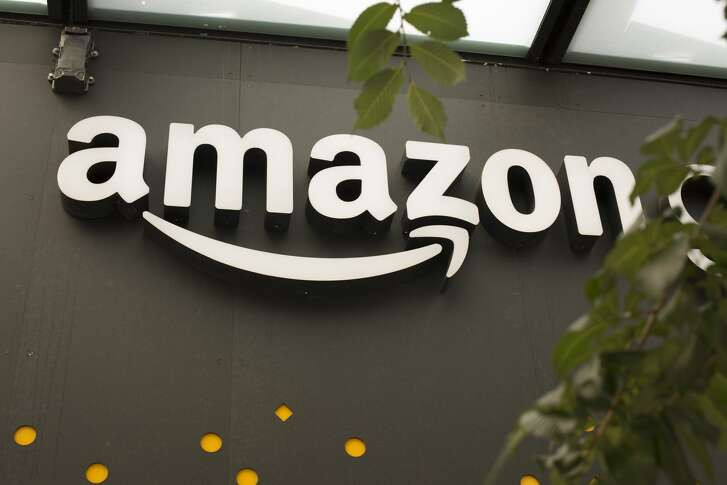 SEATTLE, WA - JUNE 16: A portion of the sign advertising Amazon Go is seen outside the grocery store's location on June 16, 2017 in Seattle, Washington. Amazon announced that it will buy Whole Foods Market, Inc. for over $13 billion dollars.  (Photo by David Ryder/Getty Images)
