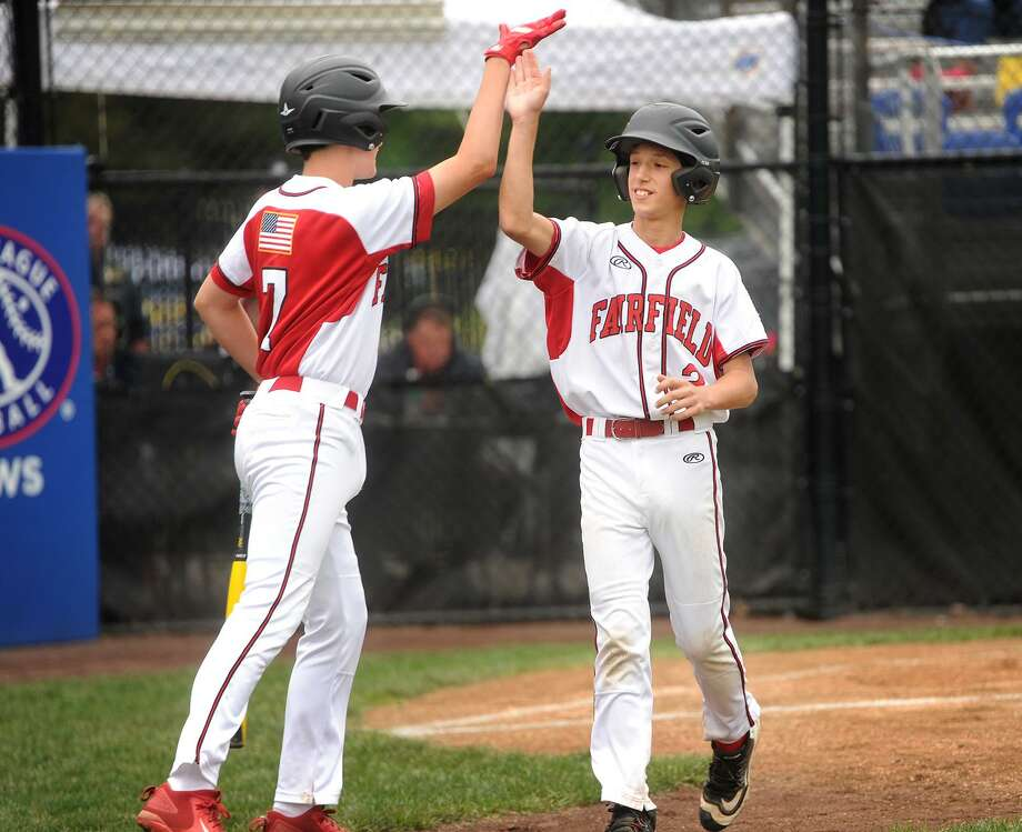 Fairfield American's Tyler Bauer, left, congratulates his teammate Matthew Vivona following Vivona's two-run home run in the first inning against South Portland, Maine, on Monday in Bristol. Vivona also had a solo home run and a triple in the game. Photo: Brian A. Pounds / Hearst Connecticut Media / Connecticut Post