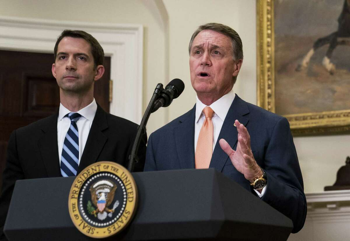 FILE -- The Raise Act by Sens. Tom Cotton, R-Arkansas, and David Perdue, R-Georgia, would overhaul decades of immigration policy by replacing a system that favors family ties with preferences based on skills. Perdue is accused of taking a student's phone Saturday, when the student approached the senator with questions about voter suppression in Georgia.