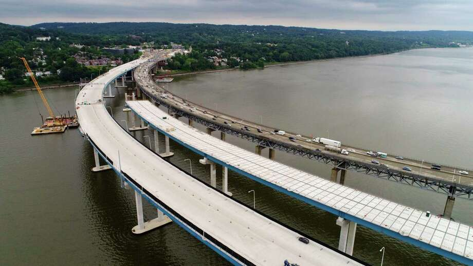 In this July 25, 2017 photo, construction continues on the spans of the new Governor Mario M. Cuomo Bridge, left, as vehicles make their way on the the Tappan Zee Bridge over the Hudson River, near Tarrytown, N.Y. Gov. Andrew Cuomo announced, Thursday, July 27, 2017, that half of the Tappan Zee Bridge replacement will open Aug. 25. It is named for his father, Mario Cuomo, who was governor from 1983 to 1994. (AP Photo/Julie Jacobson) ORG XMIT: NYJJ301 Photo: Julie Jacobson / Copyright 2017 The Associated Press. All rights reserved.