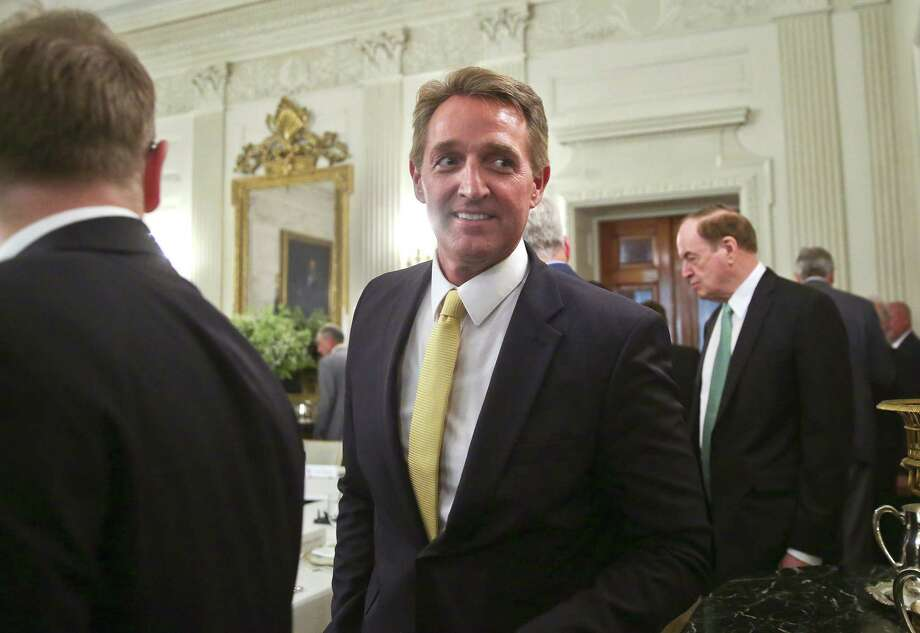Sen. Jeff Flake, R-Ariz., center, walks to his seat as he attends a luncheon with other GOP senators and President Donald Trump in the State Dinning Room of the White House in Washington. His new book ensures that his next meeting with the president might not be as cordial. Photo: Pablo Martinez Monsivais /Associated Press / Copyright 2017 The Associated Press. All rights reserved.