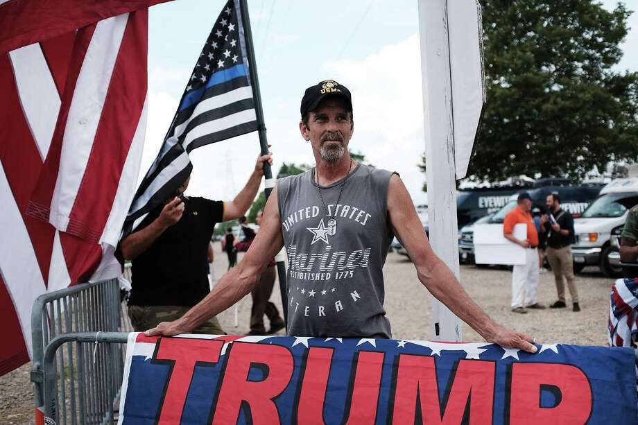 Supporters of President Donald Trump argue with anti-Trump protesters outside  Suffolk Community College last month. Many of us will never agree on politics. But if we try harder to listen, we might realize that we are on the same page more often than we realize. Photo: Spencer Platt /Getty Images / 2017 Getty Images