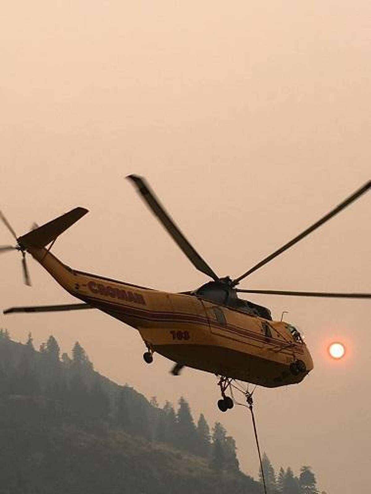 Helicopter at Foster Field helibase headed to fight the Diamond Creek Fire.