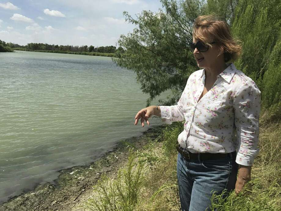 Marianna Trevino-Wright, the executive director of the National Butterfly Center, stands on the banks of the Rio Grande. Visitors currently have access to the river through the center where monarchs, queens and skippers can be viewed sipping from the green waters. Photo: Aaron M. Nelson, San Antonio Express-News / San Antonio Express-News / San Antonio Express-News