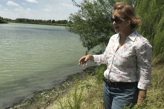 Marianna Trevino-Wright, the executive director of the National Butterfly Center, stands on the banks of the Rio Grande. Visitors currently have access to the river through the center where monarchs, queens and skippers can be viewed sipping from the green waters.