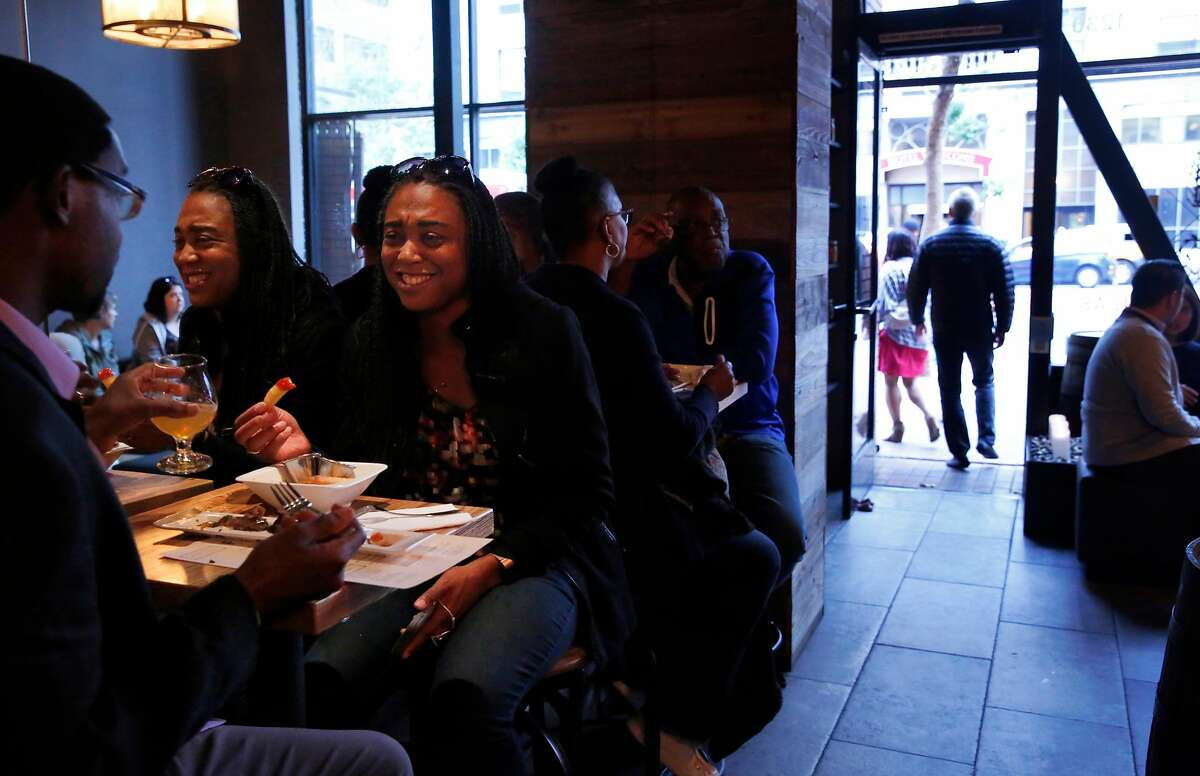 Hamilton-goers Leon Ollison, left, and Charina Moore eat pre-show appetizers in the Fermentation Lab August 5, 2017 in San Francisco, Calif. Hamilton concluded its run in San Francisco on Saturday evening.