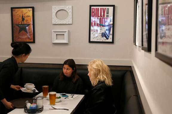 Hamilton-goers Gina Alexander, left, and Nancy Alexander are served their pre-show dinner by Abigail Kim in SAMS American Eatery August 5, 2017 in San Francisco, Calif. Hamilton concluded its run in San Francisco on Saturday evening.