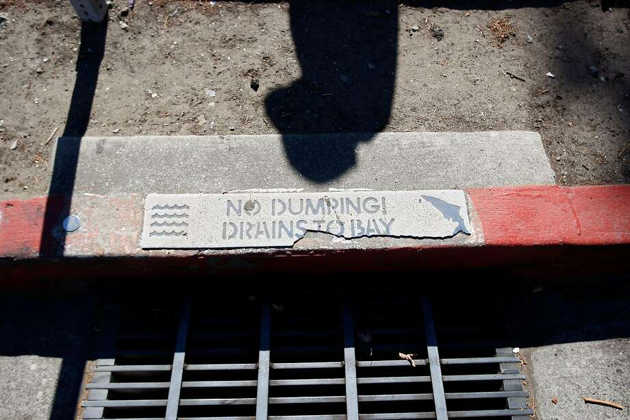 Water that rushes down storm drains is considered waste and is lost to water-starved California. Proposed legislation would change how storm water is considered under the law and allow communities to capture and clean it for use. Photo: Michael Short, Special To The Chronicle