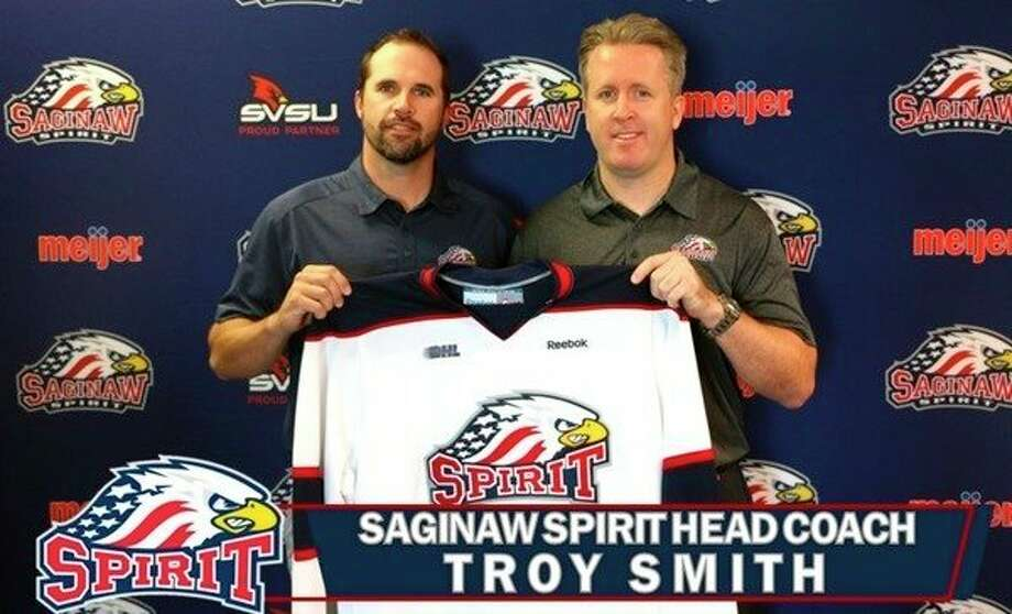 New Saginaw Spirit head coach Troy Smith, right, stands with Spirit general manager Dave Drinkill. (Photo from saginawspirit.com)