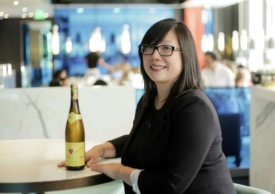 "Yauatcha sommelier Angie Chang, touts the 2015 Zind-Humbrecht Gewurztraminer for its ""silky texture on the palate."" Photo: Elizabeth Conley, Staff / © 2017 Houston Chronicle"