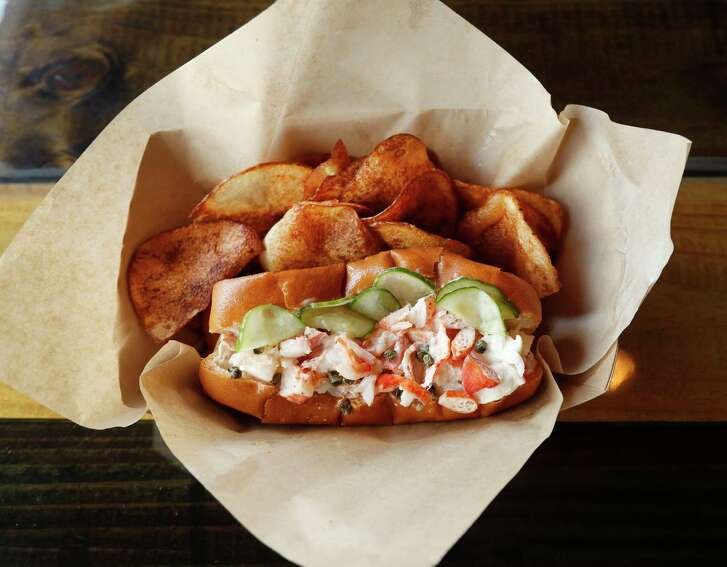 South Bank Seafood Bar's lobster roll is served on a toasted garlic roll with house-made pickles.