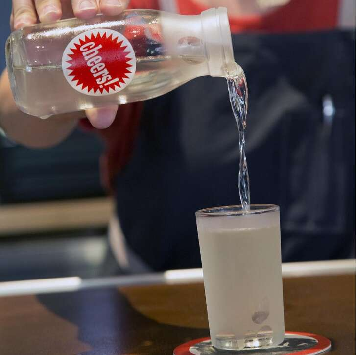 """The Izakaya """"Midori"""" Milk Punch requires several days of preparation but it's one of the Midtown restaurant's best selling cocktails, made with bitter melon, honeydew, gin, sake and milk"""