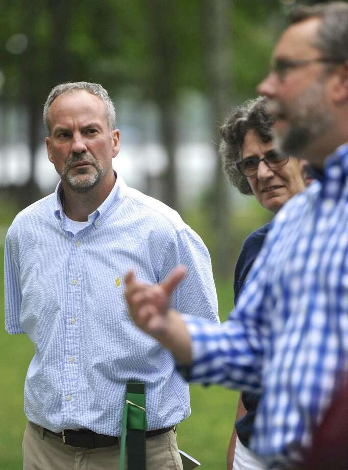 Dan Calhoun, Director of Park & Recreation, listens to Mayor David Gronbach  during the  grand reopening of Lynn Deming Park after $1 million in renovations, Monday, August 7, 2017, in New Milford, Conn. Photo: H John Voorhees III / Hearst Connecticut Media / The News-Times