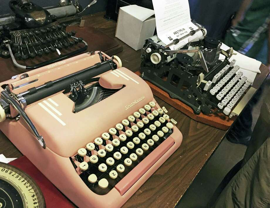 """In this April 23, 2017 photo, vintage typewriters are on display at a """"type-in"""" in Albuquerque, N.M. """"Type-ins"""" are social gatherings in public places where typewriter fans test different vintage machines. The vintage typewriter is making a comeback with a new generation of fans gravitating to machines that once gathered dust in attics and basements across the country. (AP Photo/Russell Contreras) Photo: AP / Copyright 2017 The Associated Press. All rights reserved. This material may not be published, broadcast, rewritten or redistribu"""