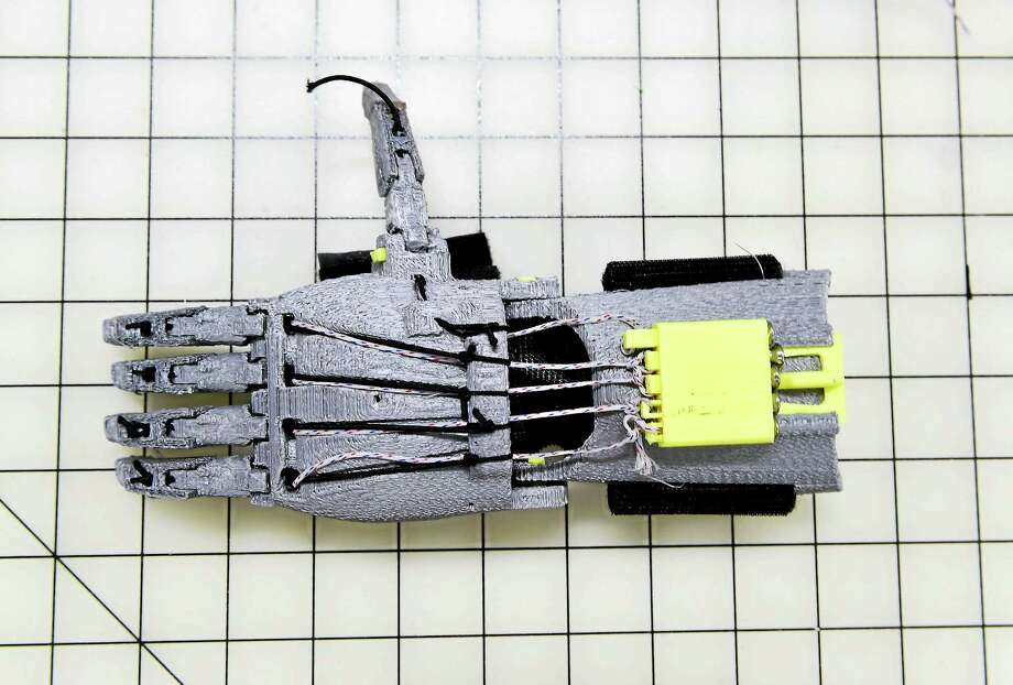 (Peter Hvizdak - New Haven Register)West Haven, Connecticut: May 7, 2017. A functional mechanical prosthetic of a hand made by a 3D  printer. Photo: Digital First Media / Peter Hvizdak
