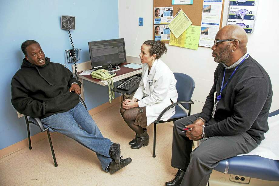 Adrian Heggie, left, receives counseling from Dr. Lisa Puglisi and Jerry Smart at the Transitions Clinic. Puglisi is the director, and Smart a community health worker at the clinic, a program that provides health care to those released from prison.Photos by Derek Torrellas Photo: Digital First Media