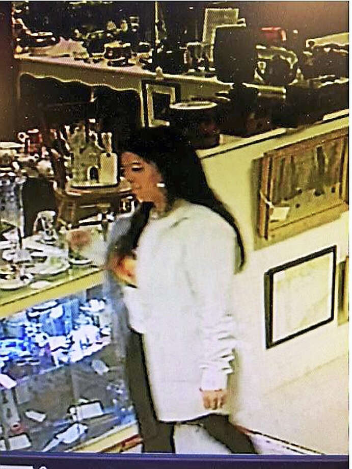 Courtesy Old Saybrook policeAuthorities are searching for a couple they say took a bracelet worth nearly $13,000 from an Old Saybrook antique shop. Photo: Digital First Media