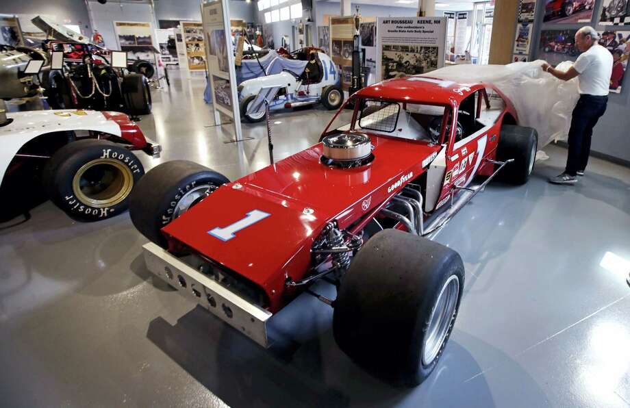 In this Wednesday, May 31, 2017 photograph, Dick Berggren, president of the North East Motor Sports Museum, uncovers the 1978 NASCAR-Modified race car driven by Geoff Bodine, at the museum in Loudon, N.H. The museum dedicated to motorsports in New England resides just outside the front gates the New Hampshire Motor Speedway. (AP Photo/Charles Krupa) Photo: AP / Copyright 2017 The Associated Press. All rights reserved.