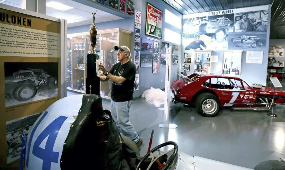 In this Wednesday, May 31, 2017 photograph, Skip Ambrose, of Meredith, N.H., polishes a giant trophy at the North East Motor Sports Museum in Loudon, N.H. The museum dedicated to motorsports in New England resides just outside the front gates the New Hampshire Motor Speedway. (AP Photo/Charles Krupa) Photo: AP / Copyright 2017 The Associated Press. All rights reserved.