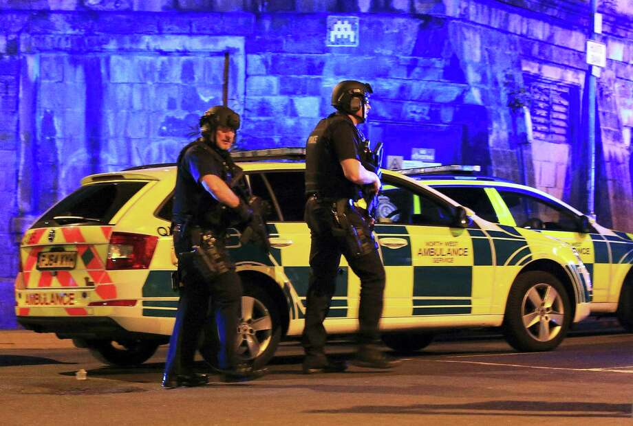 Armed police work at Manchester Arena after reports of an explosion at the venue during an Ariana Grande gig in Manchester, England Monday, May 22, 2017. Several people have died following reports of an explosion Monday night at an Ariana Grande concert in northern England, police said. A representative said the singer was not injured. (Peter Byrne/PA via AP) Photo: AP / The Press Association