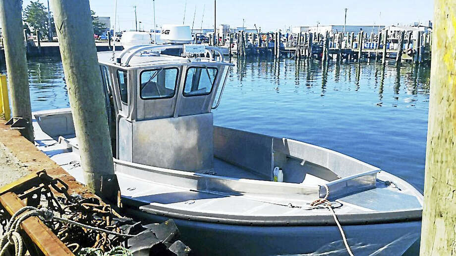 Photo by Petty Officer 3rd Class Andrew Barresi/Courtesy of hte U.S. Coast Guard The Coast Guard was searching Monday for this 32-foot aluminum boat near Block Island, Rhode Island. A mother and son from Middletown, Connecticut were reported as overdue after not returning from a fishing trip. Photo: Journal Register Co.