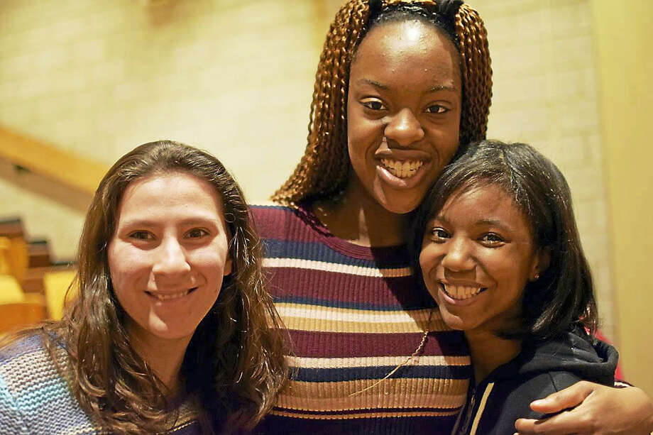 """From left are Megan Hodge, Amoge Umeugo and Chelsea Warren, among the students staging Unified Theater's """"Dancing Through the Decades"""" Wednesday through Friday at Middletown High School. Photo: Jeanne And Dan Nocera Photos"""