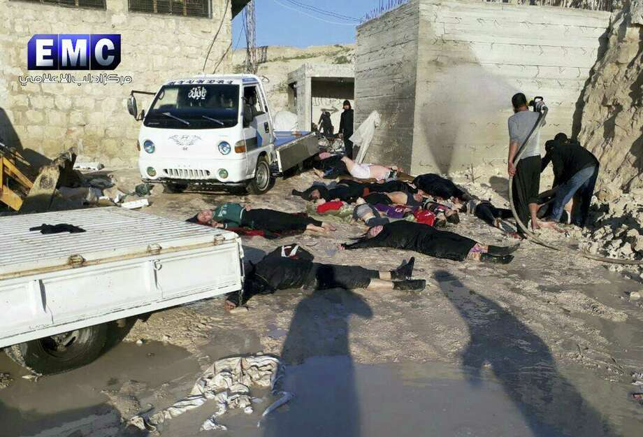 This photo provided Tuesday, April 4, 2017 by the Syrian anti-government activist group Edlib Media Center, which has been authenticated based on its contents and other AP reporting, shows  victims of a suspected chemical attack, in the town of Khan Sheikhoun, northern Idlib province, Syria. The suspected chemical attack killed dozens of people on Tuesday, Syrian opposition activists said, describing the attack as among the worst in the country's six-year civil war. (Edlib Media Center, via AP) Photo: AP / Edlib Media Center