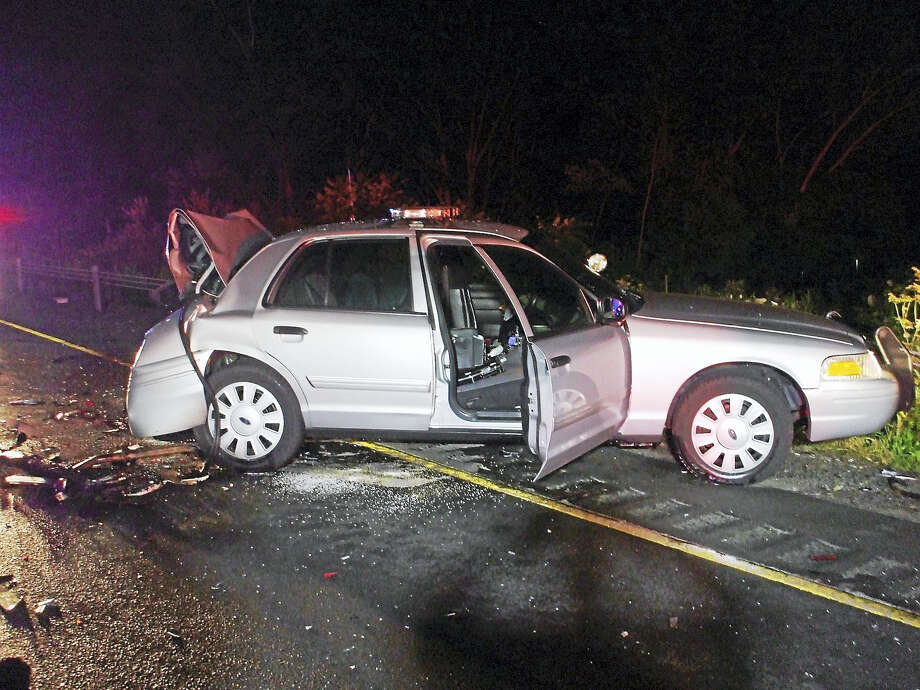 (Photo courtesy of the Connecticut State Police)A state trooper was taken to the hospital and his cruiser was severely damaged early Monday after he was hit from behind by a passing driver on Interstate 91 northbound in Middletown. Photo: Journal Register Co.