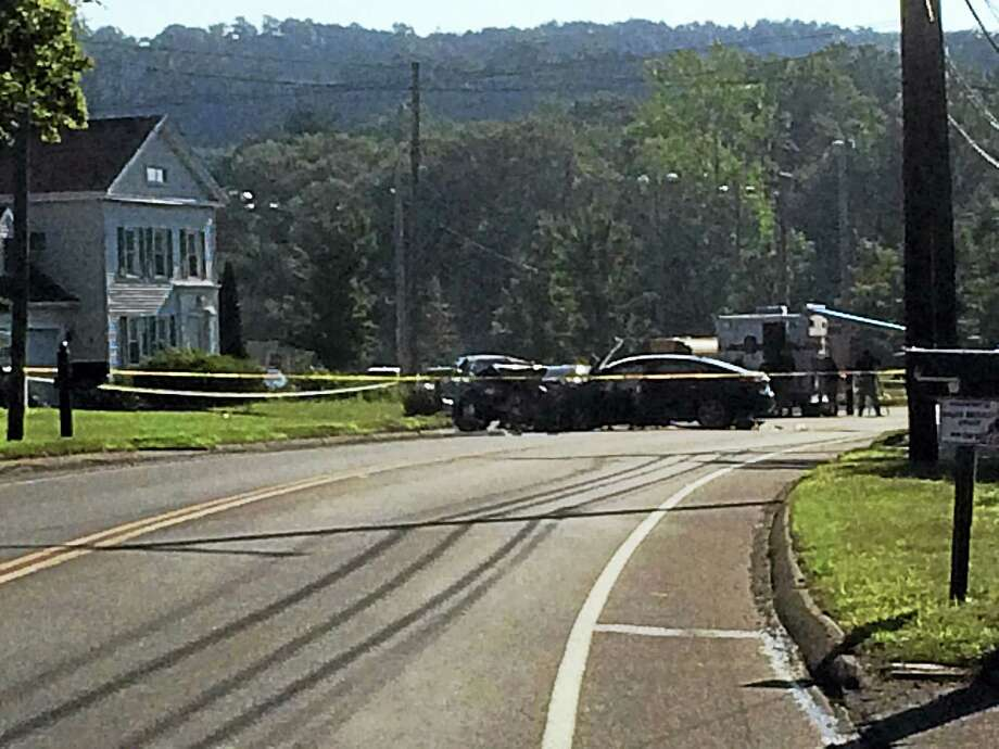 Wes Duplantier - The New Haven RegisterTwo men died early Monday after their cars crashed head-on on Route 80 near Caputo Road in North Branford. Photo: Journal Register Co.