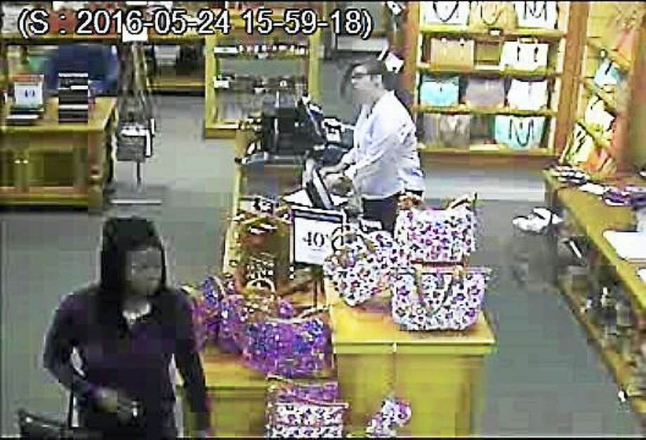 """Photo courtesy of the Clinton Police DepartmentClinton police are asking the public to help them find three women who allegedly stole """"numerous"""" purses Tuesday from Dooney & Bourke, a store at the Clinton Crossings Premium Outlets. Photo: Journal Register Co."""