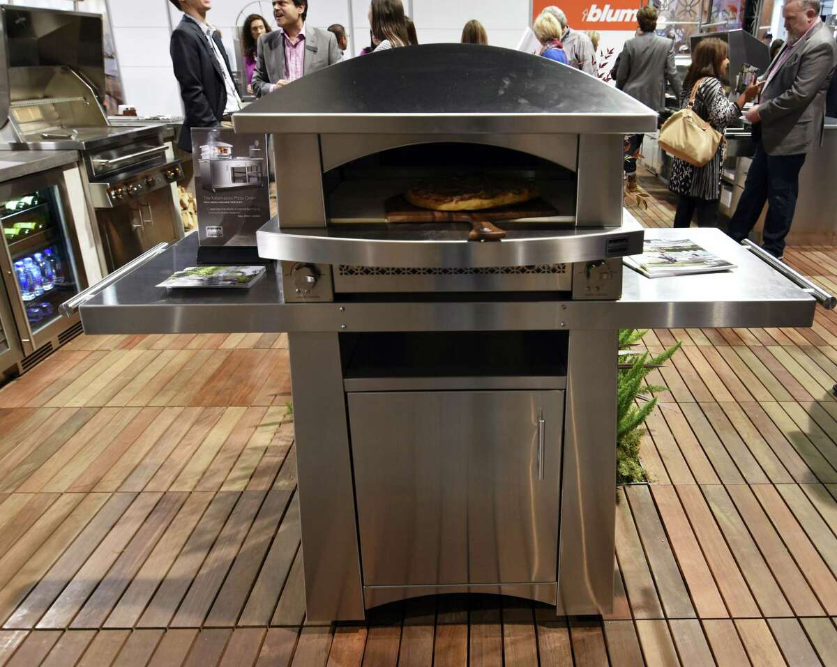 In this Jan. 2016 photo provided by Kalamazoo Outdoor Gourmet, the company debuted its $11,000 freestanding Artisan Fire Pizza Oven at the Kitchen and Bath Industry Show, in Las Vegas. (Sam Shelanski/Kalamazoo Outdoor Gourmet via AP)