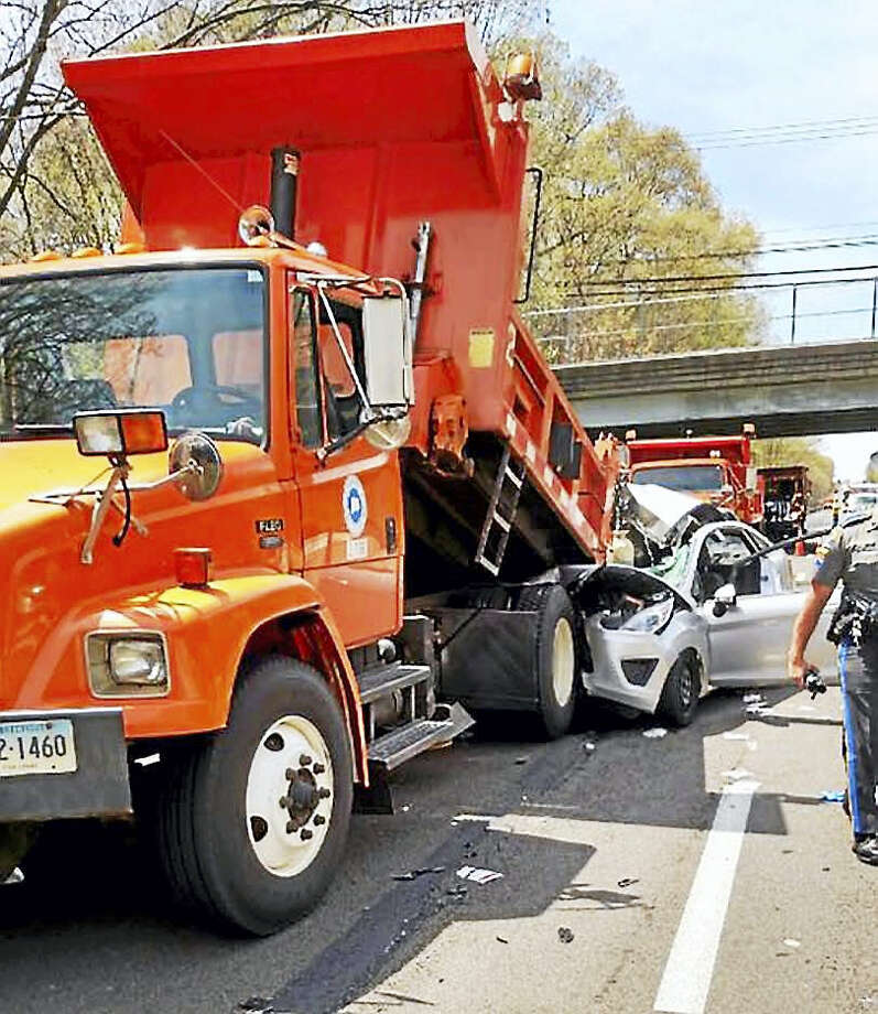 (Photos via Facebook from the CT Work Zone Safety campaign) Two people were taken to the hospital Tuesday after a car crashed into a state Department of Transportation construction truck on Interstate 95 in Old Lyme. Photo: Journal Register Co.