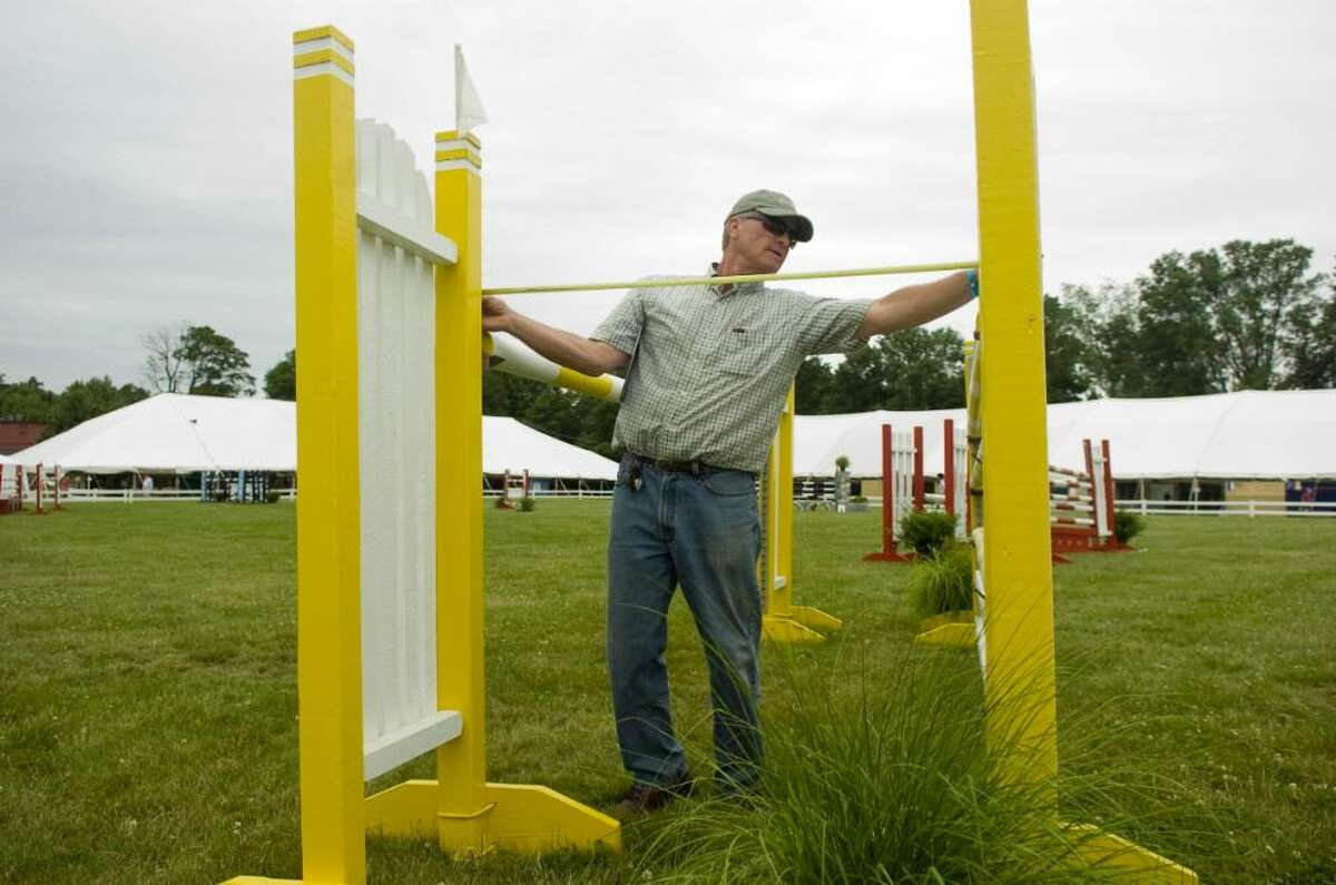 Course designer Danny Foster measures the jumps before the $5,000 Welcome class at the 80th Ox Ridge June Show June 16, 2010. The show runs through Sunday.