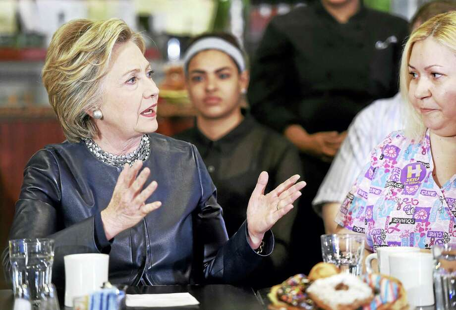 (Arnold Gold-New Haven Register)  Democratic presidential candidate Hillary Clinton (left) speaks with Maribel Rodriguez (right), a Certified Nursing Assistant, during a campaign stop at Orangeside on Temple in New Haven, Connecticut, on April 23, 2016. Photo: Journal Register Co.