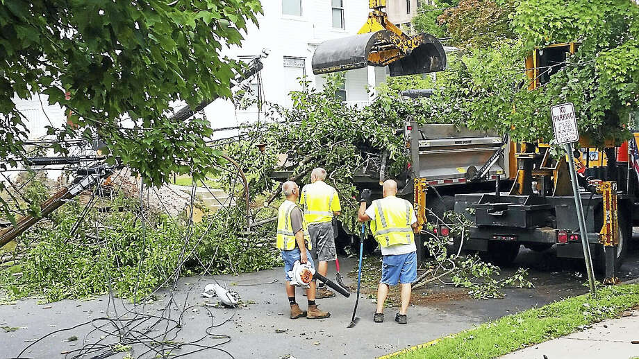 (Cassandra Day/The Middletown Press)Crews worked to clean up damage on Home Avenue in Middletown early Friday morning. Powerful storms swept through the city Thursday, bringing down several trees and power lines. Photo: Journal Register Co.