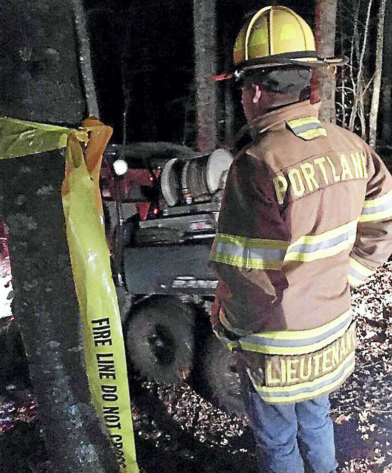 Photo courtesy of the Portland Fire Department Crews from Portland, Middletown, Westfield, East Hampton and Glastonbury battled a 15-acre brush fire Sunday in the Meshomasic State Forest. Photo: Journal Register Co.