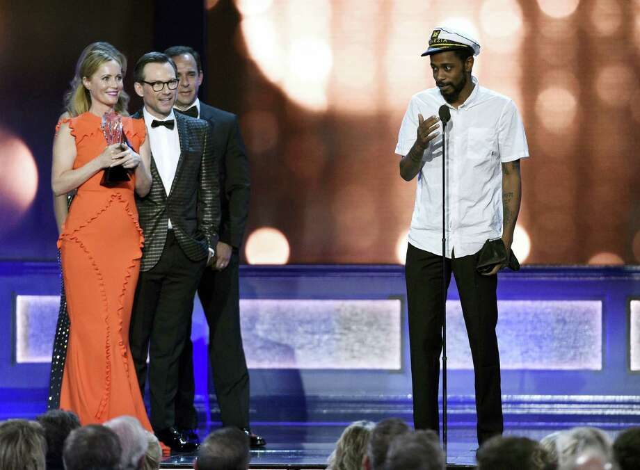 "Keith Stanfield, right, from ""Atlanta,"" interrupts as Leslie Mann, from left, and Christian Slater present the award for best comedy series to ""Silicon Valley"" at the 22nd annual Critics' Choice Awards at the Barker Hangar on Sunday, Dec. 11, 2016, in Santa Monica, Calif. (Photo by Chris Pizzello/Invision/AP) Photo: Chris Pizzello/Invision/AP / 2016 Invision"