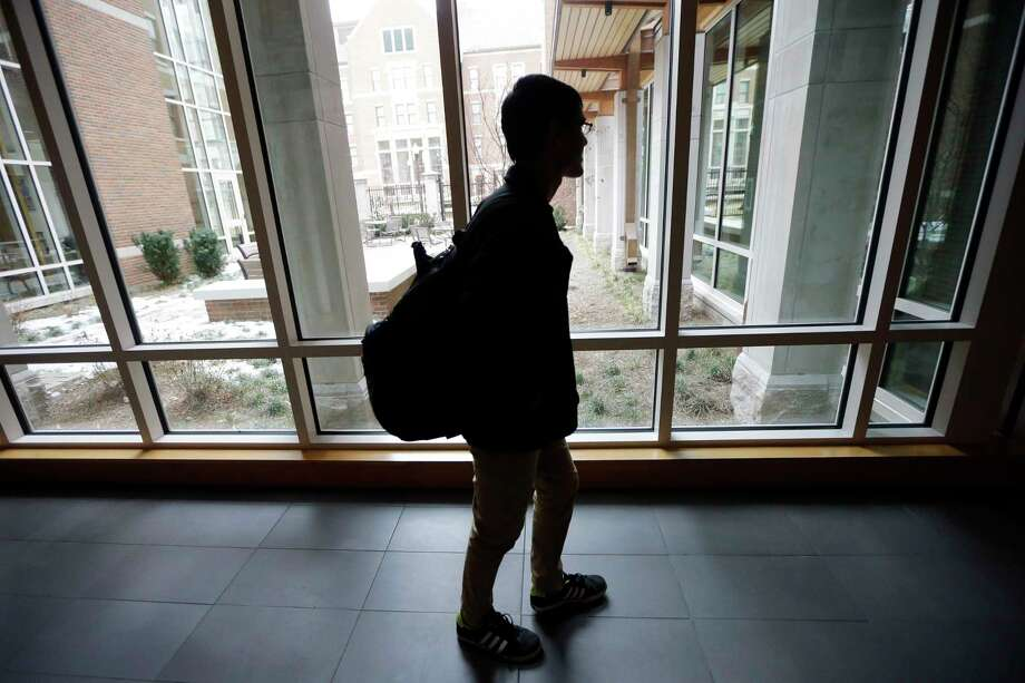 "In this Feb. 24, 2015 photo, Vivek Shah, a sophomore resident advisor at Vanderbilt University's Moore College, walks through the complex of Moore College and Warren College in Nashville, Tenn. The complex is part of the ""residential college"" model where students become part of a diverse community. Shah said he particularly has enjoyed getting to know students and faculty members whose interests sharply differ from his own. (AP Photo/Mark Humphrey) Photo: AP / AP"